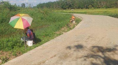 wujudkan-impian-warga-desa-rantau-keminting-melalui-perbaikan-jalan-tmmd-kodim-hst
